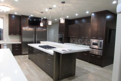 Kitchen-stainless-steel-appliances-sapele-finish-cabinets